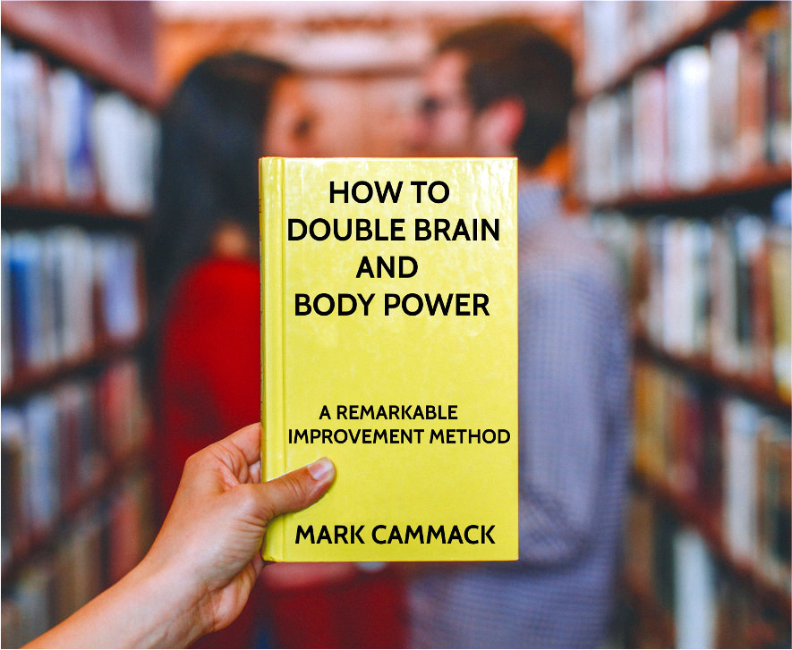 person holding up copy of book How To Double Brain And Body Power in book store