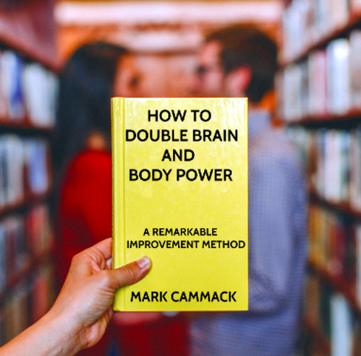 Person holding copy of book How To Double Brain And Body Power in book store